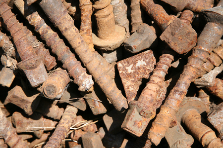 Old rusted bolts sleepers screws as a background