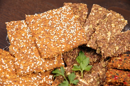 preservatives: Healthy bread crackers from grain seeds sesame spices healthy food. Cutted  pieces grain bread crackers from seeds