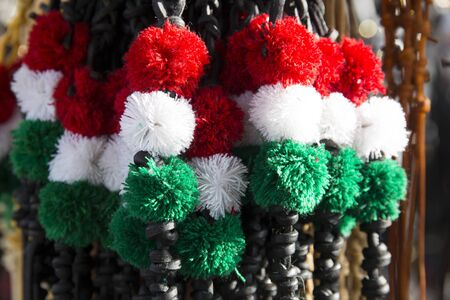 Red white and green colored whips at the farmers market for sale Stock Photo