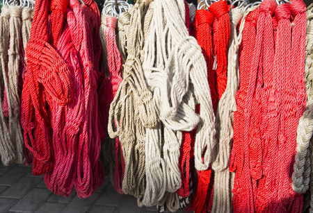 Hand made red and white halter equipment for horses and horsemen for sale on retail market rural scene