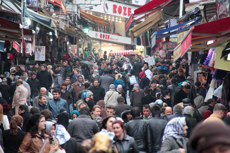 close p: ISTANBUL, TURKEY - April 12, 2012: Grand Bazaar in Istanbul with unknown people in crowd. It is one of the largest and oldest covered markets in the world.