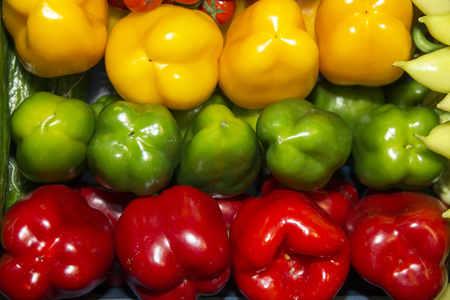 peppery: Colorful sweet bell peppers on retail market for sale