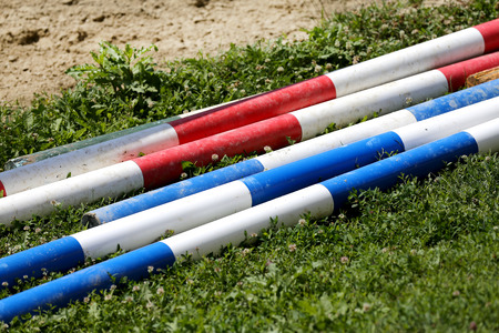 Multi colored image of show jumping poles at the show jumping arena. Wooden barriers for jumping horses as a background Stok Fotoğraf