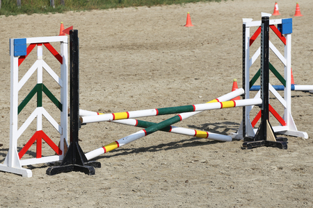 Multi colored image of show jumping poles at the show jumping arena. Wooden barriers for jumping horses as a background Banque d'images