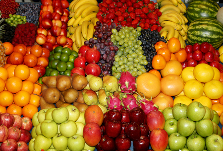 Background from freshly picked apples, pears, bananas, grapes, strawberries, cranberries, lemons, melons, raspberries, currants, blackberries, peaches, gooseberries, apricots, peaches