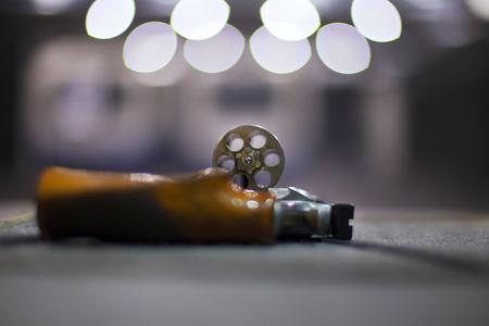 Handgun in the shooting range in backlight.