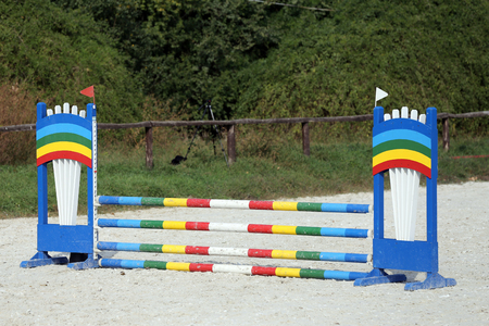 Colorful photo of equestrian obstacles. Empty field for horse jumping event competition
