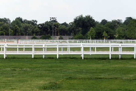 Empty racing track racecourse without horses and riders Фото со стока