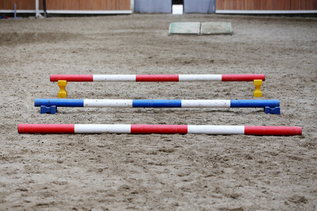 Empty field for equitation trainings or competition in empty riding hall