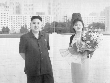 Pyongyang, North-Korea - November 13, 2011: Scan of an official photography of North-Korean leader Kim Jong-un and his wife Kim  Ri Sol-ju or Lee Seol-ju