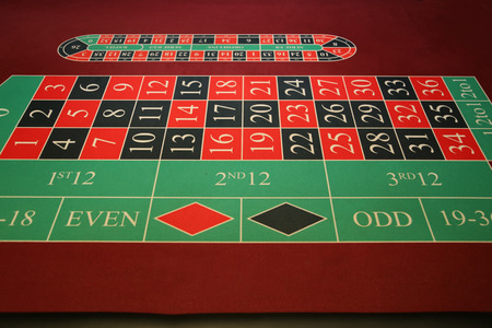 Close-up vibrant image of green casino table on black background Stock Photo