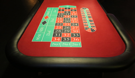 American roulette table on reddish background