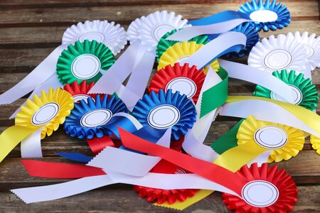 Equestrian sport trophys badges rosettes on table at equestrian event