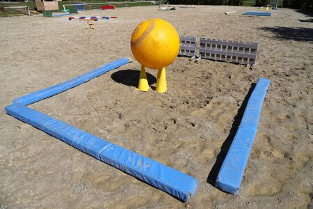 Obstacles for horses in a riding school.Various colorful obstacles for equestrian training  스톡 콘텐츠