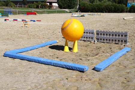 Obstacles for horses in a riding school.Various colorful obstacles for equestrian training