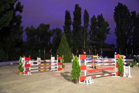 Obstacles and barriers on a show jumping field without people