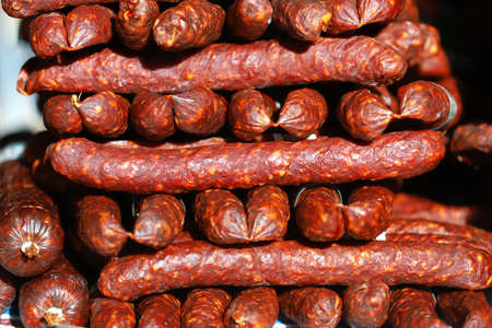 Traditional famous hungarian sausages arranged at the stand