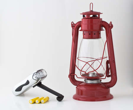 outage power: Emergency or power outage kit: kerosene lantern, batteries and a flashlight Stock Photo