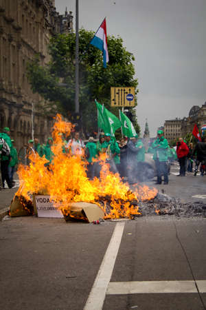 protestors: Protestors burn scrabble during trade union march in Luxembourg city