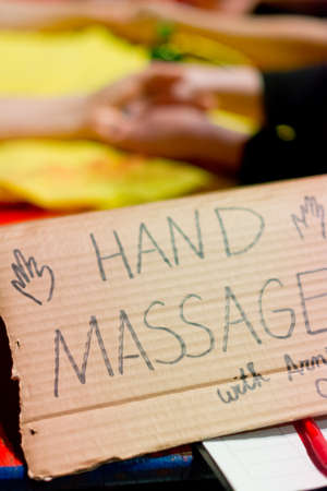 two and two thirds: Hand made cardboard sign advertising hand massage  Stock Photo