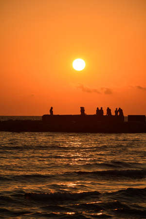 two and two thirds: People on a pier during sunrise in Mamaia