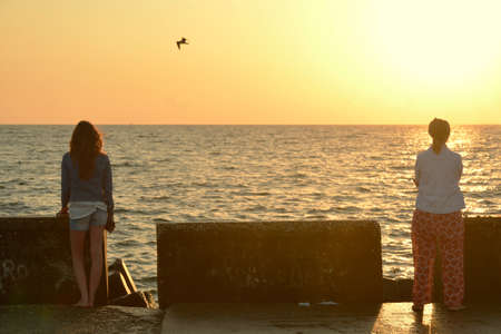 two and two thirds: Two women watching the sea early in the morning in Mamaia