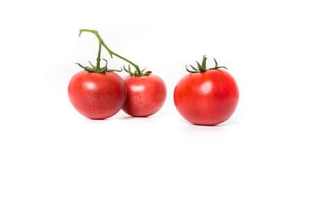 Three cherry tomatoes isolated on white background Stock Photo