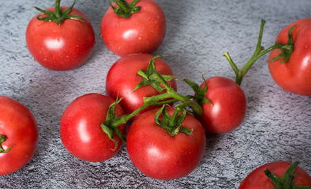 Fresh tomatoes in a plate on a dark background. Harvesting tomatoes. Top view Archivio Fotografico