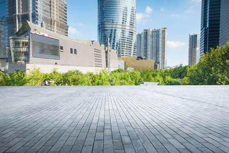 empty, modern square and skyscrapers under sunbeam Reklamní fotografie