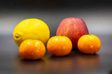 Fresh fruits on dark background