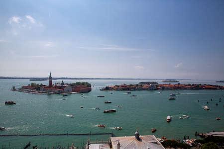 Islands of San Giorgio Maggiore, Giudecca and San Lazzaro degli Armeni. Heavy ship, boat and Vaporetto traffic in Venetian Lagoon as seen from St. Mark's Campanile, Venice, Italy Stock Photo