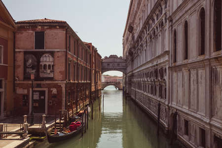 The enclosed bridge of Sighs over Rio di Palazzo which connects the New Prison and the Dodge's Palace at sunset, Venice Editorial