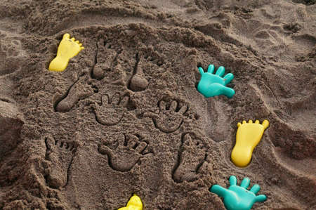Hands mark on sand