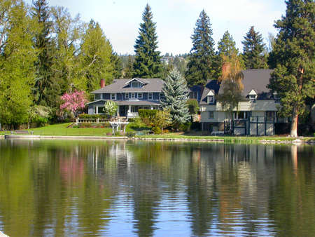 houses on the water: Lake Side Paradise Stock Photo