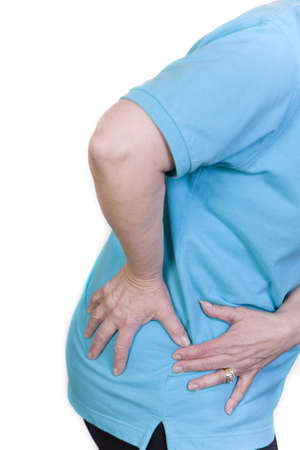 hand on hip: Woman with hip pain Stock Photo