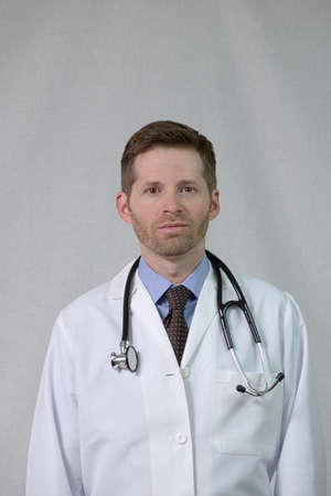 white coat: Serious Physician with Stethoscope and White Coat
