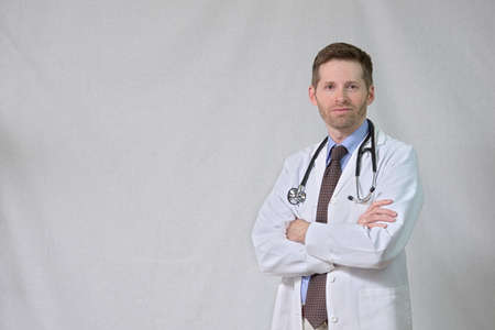 Serious Physician with crossed arms