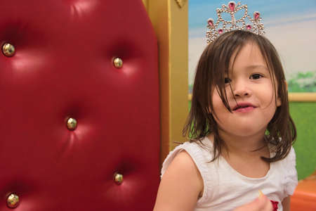asian toddler: Asian toddler with tiara on throne
