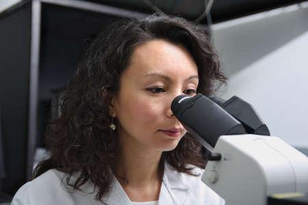 Asian female scientist at microscope Stok Fotoğraf