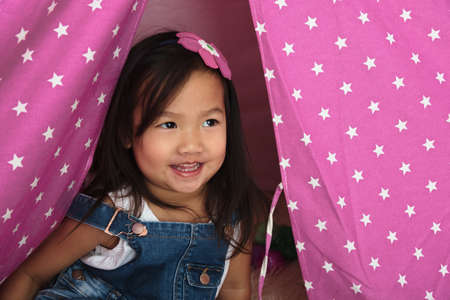 asian toddler: Asian toddler smiling and playing