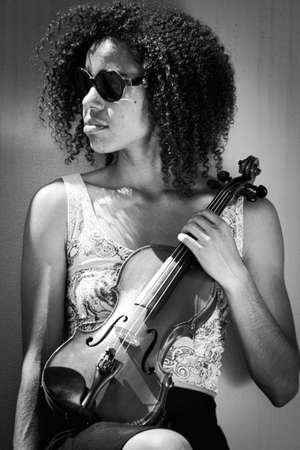 African American Woman wearing sunglasses and holding violin