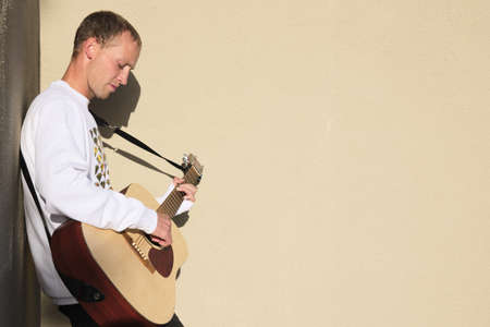 Male guitar player playing acoustic guitar
