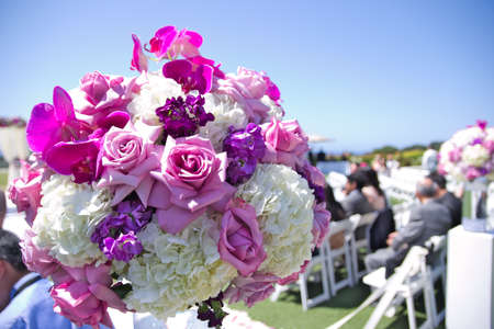 Bouquet of roses and flowers at wedding outside Stock Photo