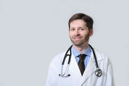 Smiling Physician with beard wearing stethoscope