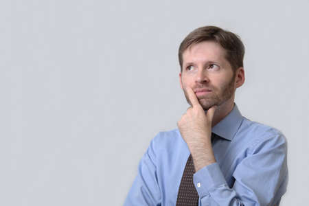 Thinking business man with beard Stock Photo