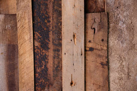 Overlapping aged wooden boards with nails