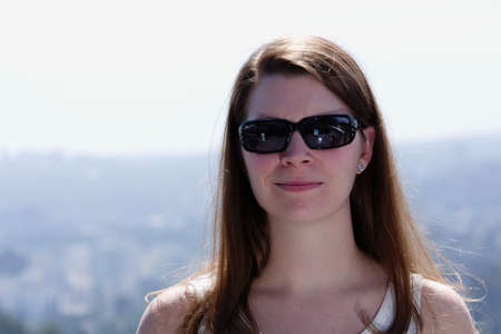 Young woman with sunglasses and smirk Stock Photo