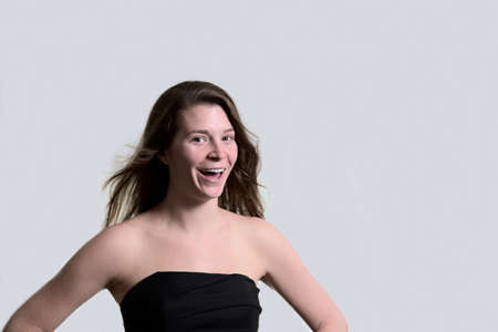 light hearted: Laughing young woman with strapless black dress Stock Photo