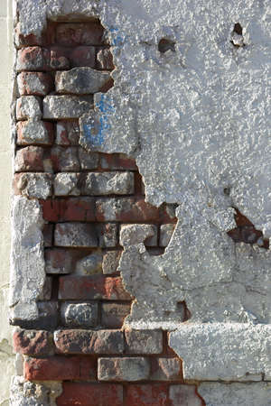 Crumbling wall of brick and plaster