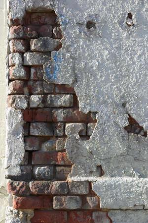 crumbling: Crumbling wall of brick and plaster